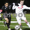 Woburn: Brian Connery from Masconomet challenges a Winchester defender for a loose ball during their teams' Division 2 North final in Woburn on Sunday. Masconomet won the game 2-0 to advance to the next tournament round. Photo by Matthew Viglianti/Staff Photographer Sunday, November 16, 2008.