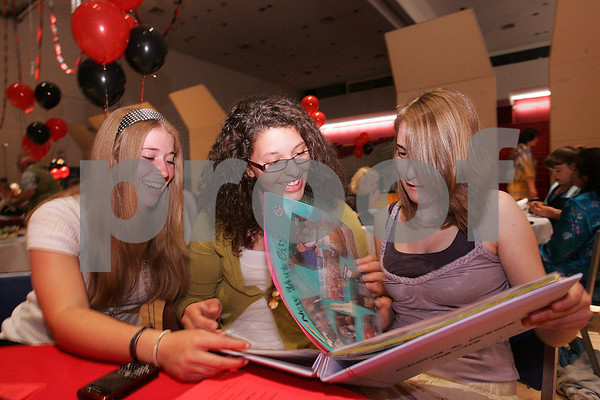 Salem: From left to right, Salem freshmen Jessica King, Victorya Silva, and Emily Kent, all members of the Salem High School band, flip through a chorus and drama scrapbook at the Salem High School Performing Arts Awards dinner on Tuesday. Photo by Matthew Viglianti/Staff Photographer Tuesday, June 9, 2009.
