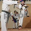 Danvers: Daniel Flaherty leaps to kick a padded target held by Master Soon Woo Hong during practice with the demonstration team at the Tigers Tae Kwon Do Academy on Maple Street in Danvers on Tuesday. Photo by Matt Viglianti/Salem News Tuesday, October 21, 2008