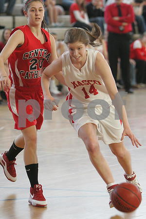 Topsfield: Masconomet junior Emily Winskowicz dribbles past Gabie Polce during Masco's home game against Central Catholic in Topsfield on Sunday. Photo by Matthew Viglianti/Staff Photographer Sunday, February 1, 2009.