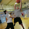 Salem: Dario Medrano, 16, out jumps Odanis Ventura, 17, both from Salem, for a rebound during a pickup basketball game at the Salem YMCA on Sunday afternoon. Several of the boys playing in the game plan to try-out for the high school basketball team this week. At right, Michael Sanchez, 13, from Salem, anticipates a loose ball. Photo by Matt Viglianti/Salem News Sunday, November 30, 2008