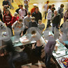 Beverly: The activity at the concession tables creates a blur as workers rush to sell slices of pizza, cookies, chips, and popcorn to fans during halftime of a state tournament basketball game between the Beverly boys team and Burlington at Beverly High School on Thursday. Photo by Matthew Viglianti/Staff Photographer Thursday, February 26, 2009.