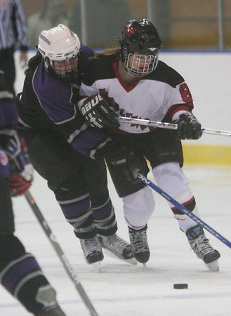 Salem: Casey McDonald from Marblehead, right, gets tied up with Katie Wrona from Cathedral during their teams' game at Rockett Arena in Salem on Wednesday. Photo by Matthew Viglianti/Staff Photographer Wednesday, January 13, 2010.