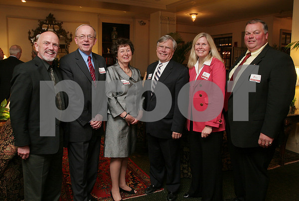 Salem: From left, David Allen George, Michael Widmer, Patricia Zaido, George Atkins, Patricia Trap, and Robert McCarthy, pose in the foyer of the Hawthorne Hotel in Salem during the annual Salem Partnership Dinner on Tuesday night. Photo by Matthew Viglianti/Staff Photographer Tuesday, March 31, 2009.
