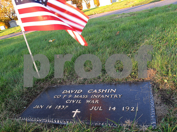 Salem: The grave stone of David Cashin at St. Mary's Cemetery in Salem was recently ammended to include recognition of his military service during the Civil War. Robert Cashin, David's brother, was also recently recognized for his Civil War service with a marker on his gravestone. The brothers were from Salem. Photo by Matthew Viglianti/Staff Photographer Sunday, November 9, 2008.