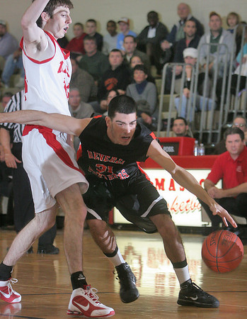 Topsfield: Beverly senior captain Curtis Manuel, right, drives past Masconomet senior Jake London  during the first half of their teams' game at Masconomet on Wednesday night. Photo by Matthew Viglianti/Staff Photographer Wednesday, December 30, 2009.