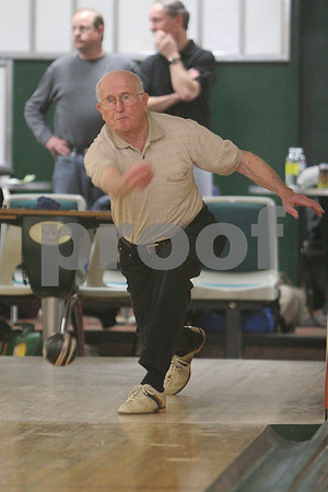 Beverly: Ken Mason, a former Beverly resident currently living in Revere, releases a throw during the second string of his league bowling match at Bowl-O-Mat in Beverly on Monday. Mason, 82, has been a member of the league for 50 years, and makes the drive from Revere every week unless the weather is too severe, and averages a score of 103. Photo by Matthew Viglianti/Staff Photographer Monday, April 6, 2009.