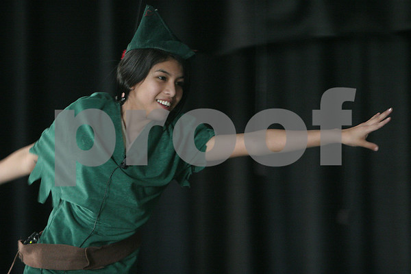 """Salem: Kimberly Barzola takes off above the stage while flying on a wire during rehearsal for the Bowditch School's production of """"Peter Pan"""" on Monday afternoon. Barzola plays Pan in the play. Photo by Matthew Viglianti/Staff Photographer Monday, March 23, 2009."""