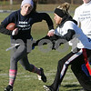 Danvers: Danvers junior Dominiqua Michaud, right, lunges to grab senior Erica Veilleux's flag during the first half of the second annual Powder Puff football game between the senior and junior class girls at Danvers High School on Sunday. Michaud made the play and stopped Veilleux before she could gain more yardage. Photo by Matt Viglianti/Salem News Sunday, November 23, 2008