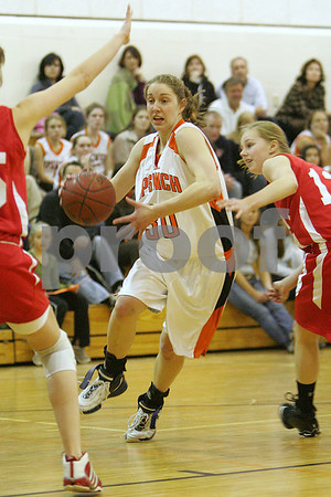 Ipswich: Ipswich senior captain Amber Smith slashes through the Masconomet defense during the first quarter of the Tiger's home game against Masco on Tuesday. Photo by Matt Viglianti/Salem News Tuesday, January 06, 2009