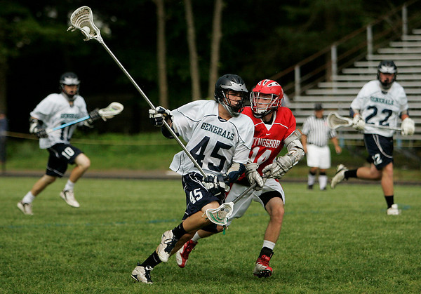 Hamilton: Chris Hughes from Hamilton-Wenham, left, streaks past Tyngsborough's Kyle Russell on his way to scoring a goal for the Generals during their home state tournament game on Wednesday. Photo by Matthew Viglianti/Staff Photographer Wednesday, June 3, 2010.