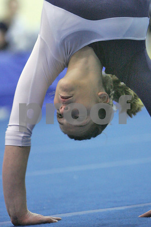Marblehead: Deanna Vecchiarello from Hamilton-Wenham cartwheels across the floor during her floor routine at the General's meet against Marblehead in Marblehead on Thursday. Vecchiarello earned a 9.4 for the routine. Photo by Matthew Viglianti/Staff Photographer Thursday, January 15, 2009.
