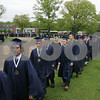 Danvers: St. John's Prep senior proceed into a tent on Ryken Field for commencement ceremonies on Sunday morning. Photo by Matthew Viglianti/Staff Photographer Sunday, May 17, 2009.