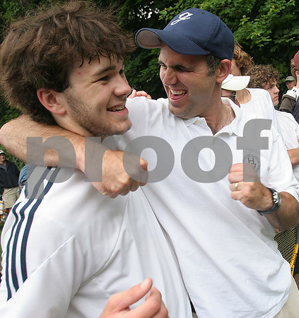 Worcester: Hamilton-Wenham head coach Joe Maher, right, hugs senior Charlie Graves after the Generals beat Mount Greylock for the state championship at Clark College in Worcester on Thursday afternoon. Photo by Matthew Viglianti/Staff Photographer Wednesday, June 10, 2009.