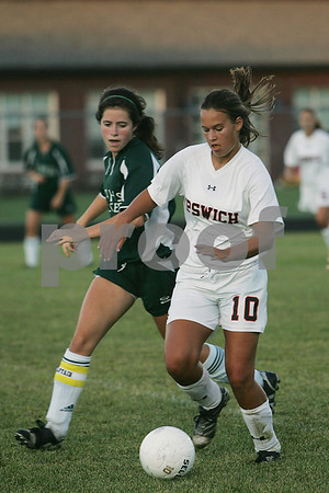 Ipswich: Ipswich junior Lizzie Fanning, right, turns the ball away from North Reading senior Kate Walsh during Ipswich's home game against North Reading on Wednesday. Photo by Matt Viglianti/Salem News Wednesday, September 10, 2008