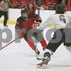 Woburn: Marblehead #6, left, carries the puck for the Headers as Shawsheen Valley senior Zachary Oles, right, skates over the defend the play during the first period of their teams' state tournament game in Woburn on Tuesday. Photo by Matthew Viglianti/Staff Photographer Tuesday, March 3, 2009.