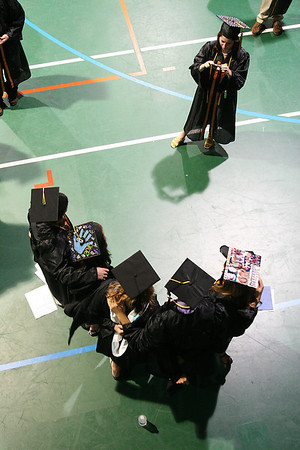Beverly: A member of the Beverly High School class of 2010 takes a photograph of her friends before the start of graduation ceremonies for the class at Endicott College in Bevelry on Sunday. Photo by Matthew Viglianti/Staff Photographer Sunday, June 13, 2010.