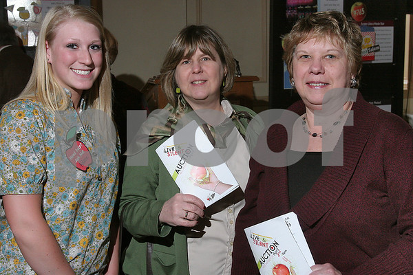 Salem: Rebecca Raymond, a junior at Salem High School, poses with former Salem High students Cindy Bell of Beverly and Mary-Ann Raby of Salem at the Foundation for Salem Public Education's annual Spring Auction in Salem on Thursday. Photo by Matthew Viglianti/Staff Photographer Thursday, April 2, 2009.