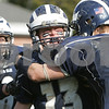 Swampscott: Swampscott junior captain Chris Cameron, center, screams in celebration while being congratulated by teammates Patrick Freemont-Smith, left, captain Stephen Moran (1), and Jon Poth, far right, for intercepting a last second pass in the endzone to seal a 21-13 win for the Big Blue over their rivals, Marblehead, to win the 100th annual Thanksgiving Day game between the two teams and capture the Northeastern Conference Small championship on Thursday afternoon in Swampscott. Photo by Matthew Viglianti/Staff Photographer Thursday, November 27, 2008.