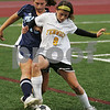 Peabody: Bishop Fenwick sophomore Sara Previte shields the ball from Peabody sophomore Brittany Lefave during the first half of Fenwick's home game against the Tanners on Monday. The game ended in a 2-2 tie. Photo by Matt Viglianti/Salem News Monday, November 03, 2008