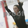 Beverly: Beverly sophomore Taylor Manzi performs on the uneven bars for the Panthers during their home gymnastics meet against Marblehead on Thursday. Photo by Matt Viglianti/Salem News Thursday, January 08, 2009