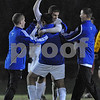 Danvers: Members of the Danvers Falcons boys soccer team congratulate senior captain Chris Ciampa (center in white) after the team's 3-0 victory over Arlington in the Division 2 North playoff quarterfinal in Danvers on Wednesday. Ciampa netted all three of the Falcon's goals last night. Photo by Matthew Viglianti/Staff Photographer Wednesday, November 11, 2009.