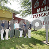 Salem: Employees of Hutchinson Medical on Highland Avenue in Salem stand outside the office with a sign announcing the company's centennial anniversary, which is this year. Photo by Matt Viglianti/Salem News Thursday, September 18, 2008