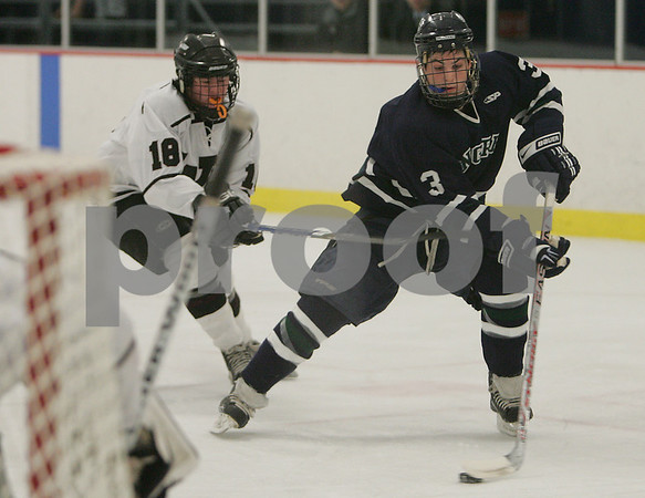 Hamilton: Pingree captain Matt MacDonald, right, moves in on the Worcester Academy goal while under pressure from Tory Cole during the first period of the Highlander's home game against Worcester Academy in Hamilton on Wednesday. Pingree lost the game 2-1. Photo by Matt Viglianti/Salem News Wednesday, December 10, 2008