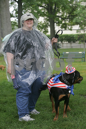 Danvers: Janine Fuller of Danvers with her dog, a rottweiler named Kobe, at the Danvers Family Festival Dog Party on Sunday. Photo by Matthew Viglianti/Staff Photographer Sunday, June 21, 2009.