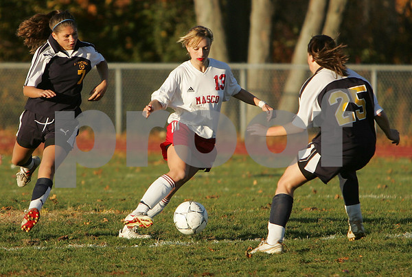 Topsfield: Lucy Gildein, a junior from Masconomet High School, center, tries to cut past Lynnfield junior Abby Tobin, right, as Tori Copelas, a Lynnfield sophomore, left, looks to help on defense during the second half of Masco's 5-2 victory over Lynnfield on Monday. Photo by Matt Viglianti/Salem News Monday, October 20, 2008