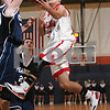 Salem: Antonio Reyes from Salem leaps to make a layup as a pair of Peabody defenders move in to stop the shot during the third period of the Witches' game against the Tanners at Salem State on Tuesday. Photo by Matt Viglianti/Salem News Tuesday, December 16, 2008