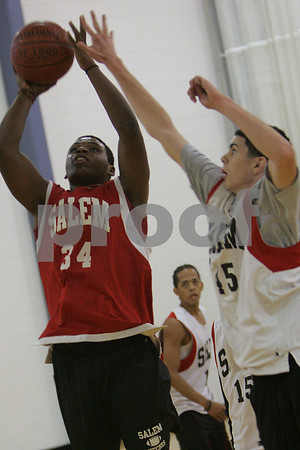 Salem: Chris Dunston, a senior at Salem High School, left, goes up for a layup as sophomore Kyle Reardon attempts to block the shot during practice on Monday. Photo by Matthew Viglianti/Staff Photographer Monday, December 8, 2008.