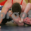 Hamilton: Chris Poole from Hamilton-Wenham, right, struggles to stay off his back as Dave Callahan from Wakefield works for the pin during a wrestling match between the two schools in Hamilton on Tuesday. Callahan would eventually win the 215 pound weight class match by pinning Poole. Wakefield won the match 34-11. Photo by Matthew Viglianti/Staff Photographer Tuesday, December 23, 2008.