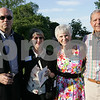 Salem: Ed and Frances Nilsson from Marblehead, left, pose with Claire and Chas Poirier from Danvers on the lawn outside the Plummer Home for Boys in Salem on Thursday during the Celebration of Community event. Photo by Matthew Viglianti/Staff Photographer Thursday, June 25, 2009.