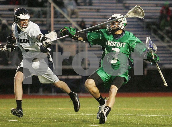 Wenham: Gordon College sophomore Stuart Knechtle, left, defends Endicott's Eddie O'Reilly during the Fighting Scots home game against Endicott on Tuesday night. Photo by Matthew Viglianti/Staff Photographer Tuesday, March 24, 2009.