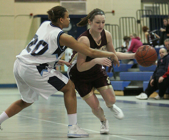 Peabody: Audrey Knowlton from Gloucester, right, dribbles past Peabody defender Janelle Rodriguez during the first quarter of their teams' game at the Peabody High School field house on Thursday night. Photo by Matthew Viglianti/Staff Photographer Thursday, January 28, 2010.