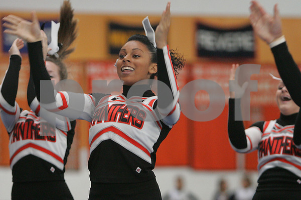 Beverly: Kaitlyn Arzu and the Beverly High School cheerleading squad shout to the crowd during their exhibition performance at the annual Beverly Halloween Classic Cheerleading Competition at the high school on Sunday. Photo by Matt Viglianti/Salem News Sunday, October 26, 2008