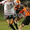 Salem: Salem sophomore Brion Likaj, left, looks to dribble past Beverly's Cam Rogers during the first half of the Witche's home game against the Panthers on Thursday night. Rogers netted the game's first goal to give Beverly a 1-0 lead, but Salem quickly answered, and won the game 2-1. Photo by Matthew Viglianti/Staff Photographer Thursday, October 29, 2009.