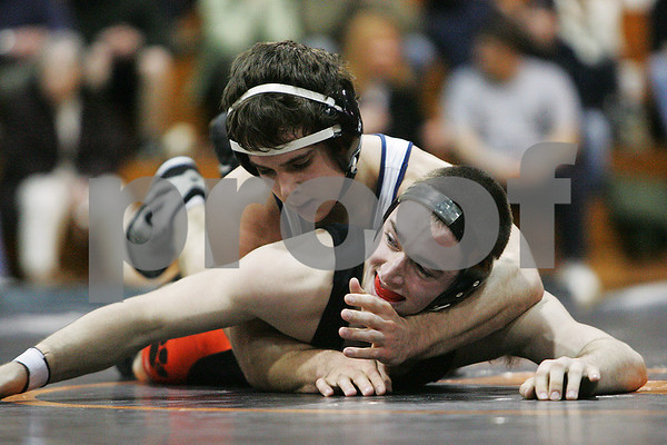 Beverly: Adam Hammdorf, a senior at Hamilton-Wenham, top, works to place a hold on Kurt Stallsmith of Beverly during their 145-pound match at their teams' meet in Beverly on Wednesday. Hammdorf won the match 8-2. Photo by Matt Viglianti/Salem News Wednesday, February 11, 2009