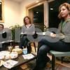 Swampscott: From right, Sonja Groundstra, Fiona Minney from Marblehead, and Loren Weston from Marblehead plan for an upcoming SHE Network fundraiser at a board meeting at Groundstra's home in Swampscott on Wednesday. The SHE Network consists of a group from Marblehead and Swampscott that help women in transition. Photo by Matt Viglianti/Salem News Wednesday, November 05, 2008