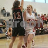 Topsfield: Masconomet junior Carly Kiernan, right, grimices as she collides with North Andover junior Katie Moroney on her way to the basket in the first period of Masco's home game against North Andover on Sunday. Photo by Matt Viglianti/Salem News Sunday, January 11, 2009