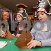 Salem: Salem brothers Jetson, 7, right, and Rocket, 6, Power get help making paper boats from Rosamond Smith from Historic New England's Phillips House at a party celebrating the anniversary of Nathaniel Bowditch's return from sea on Christmas Day in 1803 at Hamilton Hall in Salem on Sunday. Photo by Matt Viglianti/Salem News Sunday, December 14, 2008