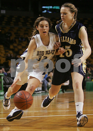 Boston: Swampscott junior Kara Gilberg drives past Archbishop Williams junior Colleen Downing during the third quarter of the Big Blue's Division 3 state tournament semifinal game against Archbishop Williams at the TD Banknorth Garden in Boston on Monday. Swampscott won the game 67-51 to advance to the Division 3 title game at the DCU Center in Worcester on Saturday. Photo by Matthew Viglianti/Staff Photographer Monday, March 9, 2009.