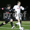 Woburn: Kevin McAllister from Masconomet carries the ball for the Chieftains while under pressure from a Winchester defender during their teams' Division 2 North final in Woburn on Sunday. Masconomet won the game 2-0 to advance to the next tournament round. Photo by Matthew Viglianti/Staff Photographer Sunday, November 16, 2008.