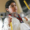 Danvers: Gabriela Molica concentrates on her technique while practicing with nunchucks during a session with the demonstration team at the Tigers Tae Kwon Do Academy in Danvers on Tuesday.  Photo by Matt Viglianti/Salem News Tuesday, October 21, 2008