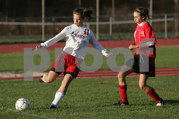 Topsfield: Masconomet sophomore Amy Griffith gets a pass away before a challenge by North Andover junior Tara Donahue during the Chieftains 4-2 win over North Andover to clinch the Cape Ann League title in Topsfield on Thursday.  Photo by Matt Viglianti/Salem News Thursday, October 30, 2008