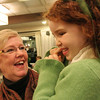 Danvers: Pam Irwin from Beverly holds her granddaughter, Aine Downey, 6, from Brookline, at a party held in honor of her retirement at the Danversport Yacht Club in Danvers on Wednesday. Irwin served as Danvers' recycling coordinator. Photo by Matthew Viglianti/Staff Photographer Wednesday, January 13, 2010.