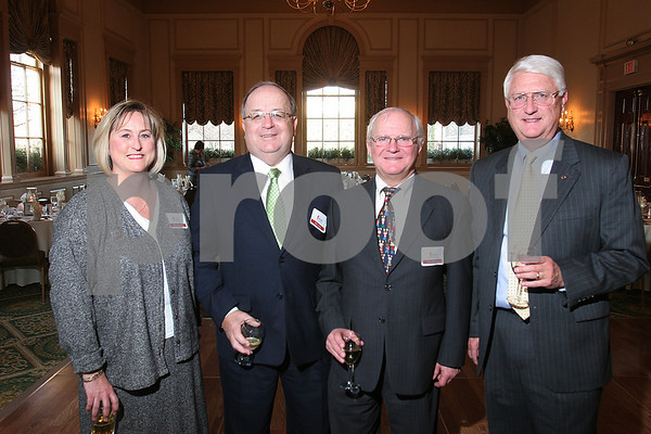 Salem: From left, Kim Downing and Bob Kelley from Salem Five Bank, pose with Tom Furlong and Richard Moore from Eastern Bank at the Salem Partnership annual dinner on Tuesday night. Photo by Matthew Viglianti/Staff Photographer Tuesday, March 31, 2009.