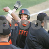 Peabody: Beverly center fielder Ethan Trowt, center, high fives his teammates after scoring a seventh inning run during Beverly's 11-3 win at Peabody on Monday afternoon. Photo by Matthew Viglianti/Staff Photographer Monday, May 11, 2009.