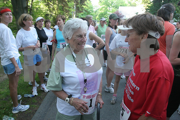 "Beverly: Louise Rossetti, left, speaks with her friend Joanne Ratcliffe of Methuen before the start of the 16th annual Louise Rossetti Road Race in Beverly on Wednesday evening. Rossetti and Ratcliffe have been friends for many years, and Ratcliffe calls Rossetti her mentor. ""I love this lady. She's the best,"" said Ratcliffe of her friend. Rossetti, who turns 88 at the end of this month, ususally runs the race, but couldn't compete this year due to a knee injury. Photo by Matthew Viglianti/Staff Photographer Wednesday, June 17, 2009."